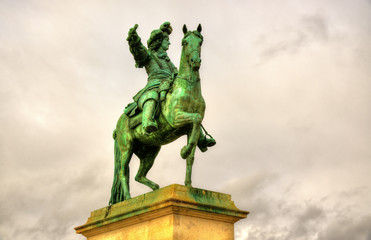 Statue of Louis XIV in front of the Palace of Versailles near Pa