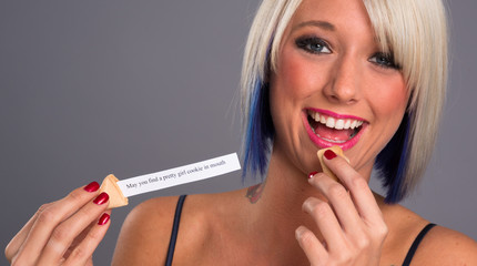 Pretty Blonde Woman Eats Fortune Cookie Showing Message