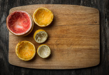 Fresh Squeezed Citrus fruit on Wood Background Rustic Style