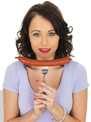 Young Woman Holding a Saveloy Sausage