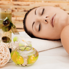 Relaxing woman at beauty spa salon