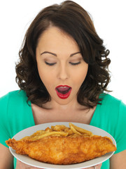 Young Woman Eating Traditional Fish and Chips