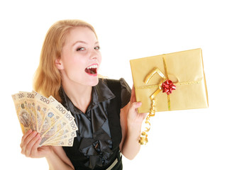 Woman with gift box and polish money banknote.