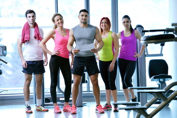 Group of people exercising at the gym