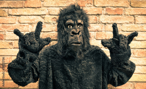 Keuken foto achterwand Aap Funny fake gorilla with rock and roll hand gesture
