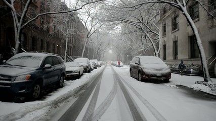 Snow covered street and cars after snowstorm, New York
