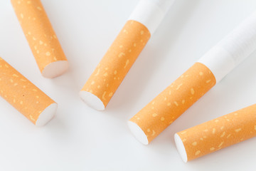 Close - up Row of Cigarette on white background .