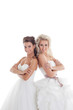 Nice girlfriends posing in elegant wedding dresses