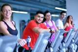 Group of people running on treadmills - 79325936