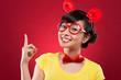 Cheerful girl in plastic glasses