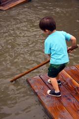 Child rafting at adventure playground