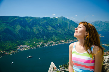 girl on the background of the bay Kotor