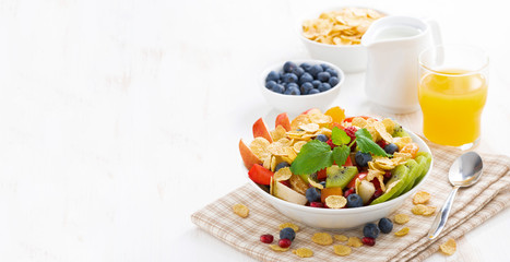 breakfast with fruit and berry salad, juice and cereal