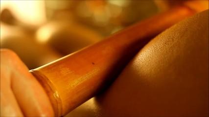 foot massage using bamboo sticks