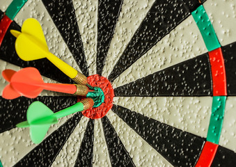 Three darts in the center of the target