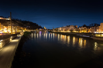 view from bridge on river Salzach at Salzburg at night