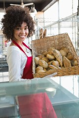 Pretty waitress carrying basket of bread