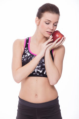 Healthy sporty girl with red apple