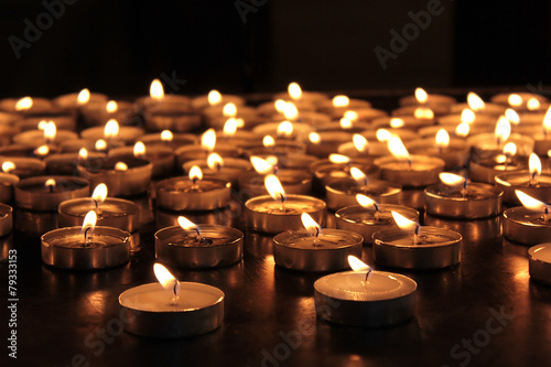 burning memorial candles - 79333153
