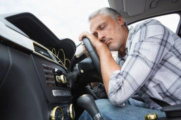 Drunk man slumped on steering wheel
