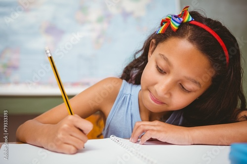 canvas print picture Little girl writing book in classroom