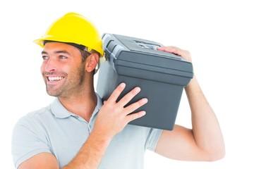 Handyman carrying toolbox on shoulder