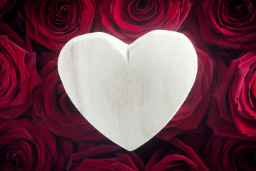 Wooden Heart on Red Roses