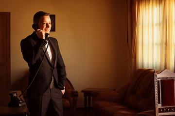 groom posing in a hotel room