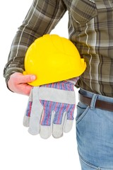 Manual worker holding helmet and gloves
