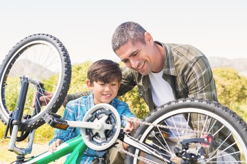 Father and son repairing bike