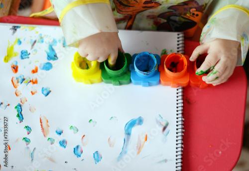 Artwork in progress - child painting - 79336727