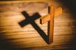 Leinwanddruck Bild - Crucifix icon on wooden table