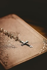 Rosary beads with bible