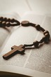 Open bible and wooden rosary beads - 79337101