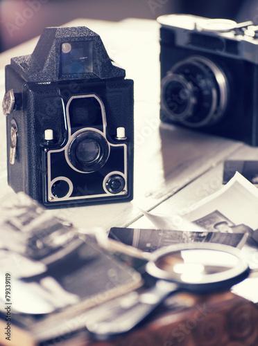 Old cameras and photos, filtered still life - 79339119