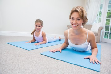 Mother and daughter doing yoga