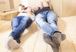 young couple relaxing after moving - 79339994
