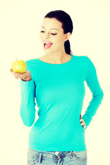 Happy woman with an apple.