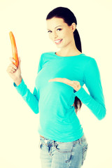 Happy young woman with the carrot.