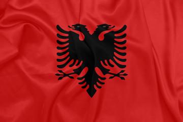 Albania - Waving national flag on silk texture