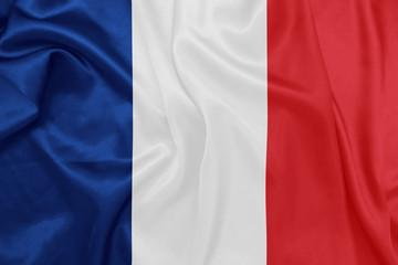 France - Waving national flag on silk texture