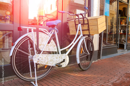 Papiers peints Velo Bicycle stands near wall on the street in Dutch city
