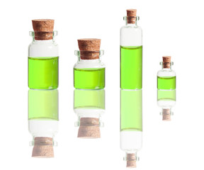 green liquid in bottles with cork isolated on white background