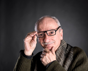 Smiling elderly man in glasses