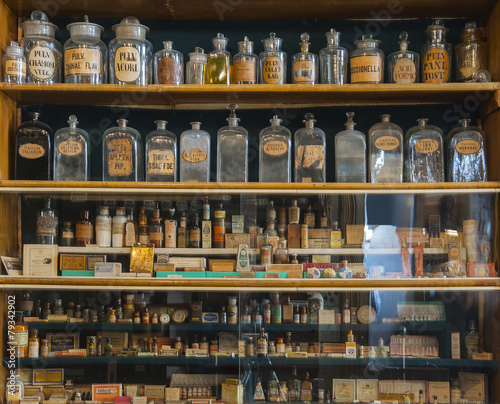 Leinwandbild Motiv Empty scent bottles in old pharmacy