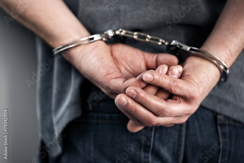 Criminal in handcuffs - 79342954