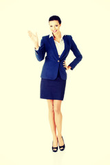 Beautiful businesswoman waving her hand.
