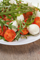 salad with mozzarella cherry tomatoes and arugula