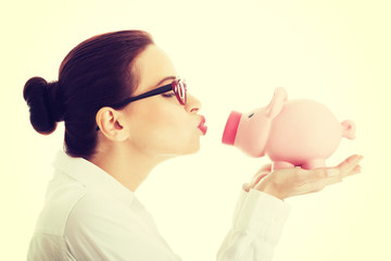 Woman holding piggy bank.