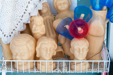 Faces made of wax